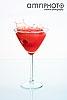 red splashing cocktail