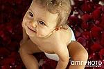 smiling baby in petals