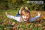 funny young girl on autumn meadow