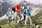four colorful senior hikers