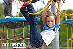 girl hanging on ropes
