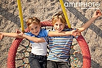 happy siblings in swing