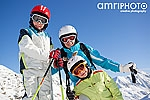 skiing instructor with smiling kids