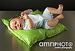 baby on green cushion