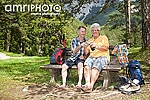 barefoot seniors on park bench