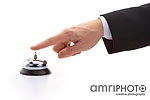 finger of businessman ringing bell